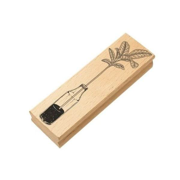 sello de madera jarron con planta